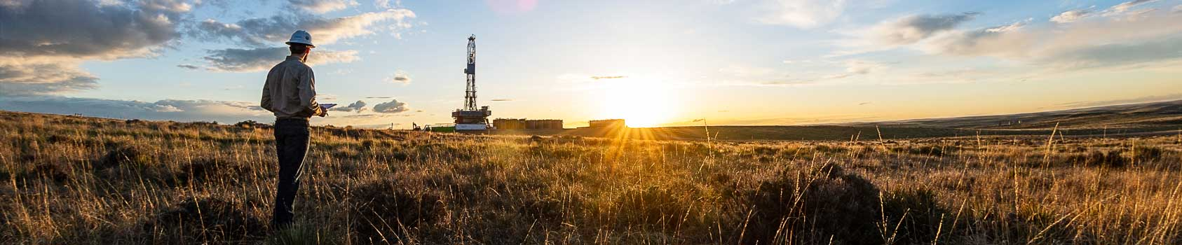 oil worker in sunny field